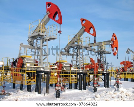 Oil and gas industry. Work of oil pump jack on a oil field. - stock photo