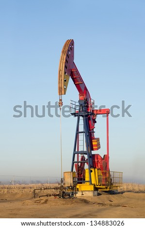 Oil and gas industry. Work of oil pump jack on a oil field. Extraction of oil. Oil industry of West Siberia - stock photo