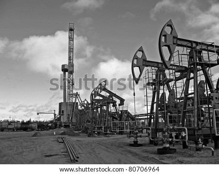 Oil and gas industry. Work of oil pump jack on a oil field. Rig. Black and white photo