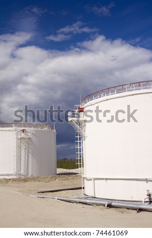 Oil and gas industry. Work of refinery petrochemical plant. Oil reservoir and storage tank of mineral oil - stock photo