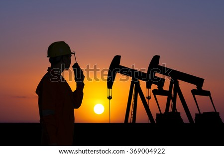 Oil and gas operator discussing.