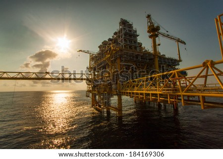 Oil and gas platform in the gulf or the sea, The world energy, Offshore oil and rig construction Platform for production oil and gas.  - stock photo
