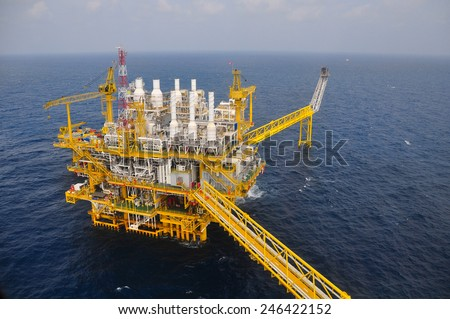 Oil and gas platform or construction in the gulf. Offshore platform for production oil and gas. View construction platform from top view and from helicopter view. - stock photo