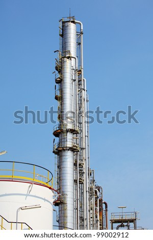 Oil and Gas Refinery Plant with distillation column and tank - stock photo