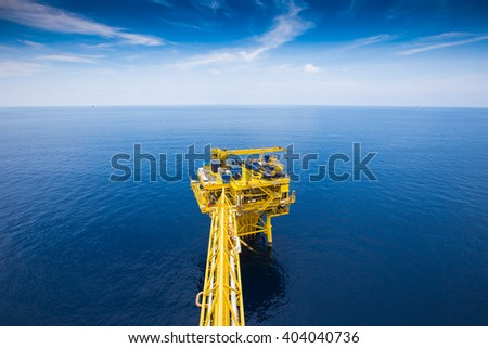 Oil and gas remote wellhead platform near central processing platform - stock photo