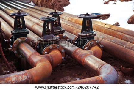 Oil and gas rusty pipe line and valves - stock photo