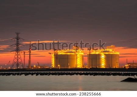 Oil and gas Storage tanks on twilight - stock photo