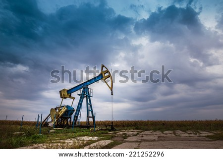 Oil and gas well, in remote rural area in Europe - stock photo