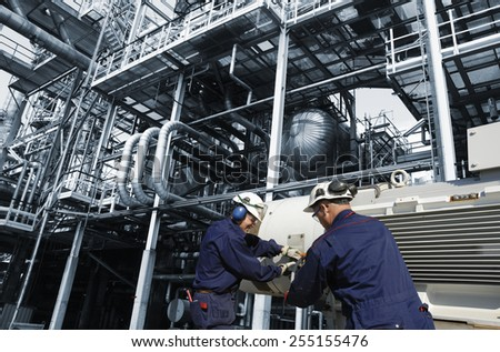 oil and gas workers inside refinery, main pump station - stock photo