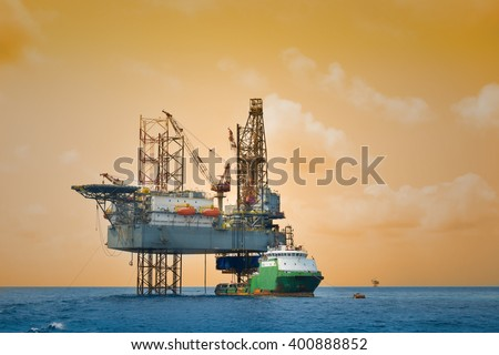 Oil and rig platform operation in north sea, Heavy industry in oil and gas business in offshore, rig operation. - stock photo