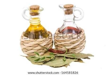 Oil and vinegar with laurel - stock photo