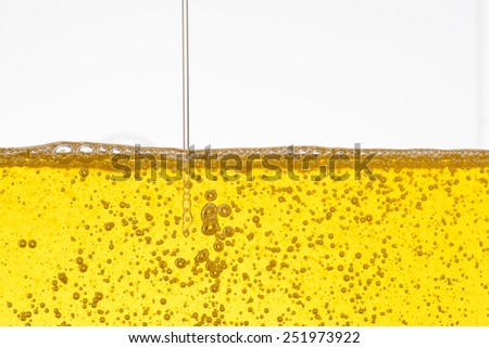 Oil background with air bubbles and pour - stock photo