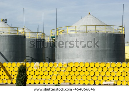Oil barrels at refinery factory - stock photo