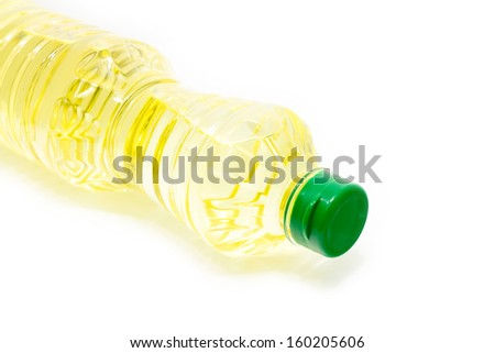 Oil bottle lays down on white background