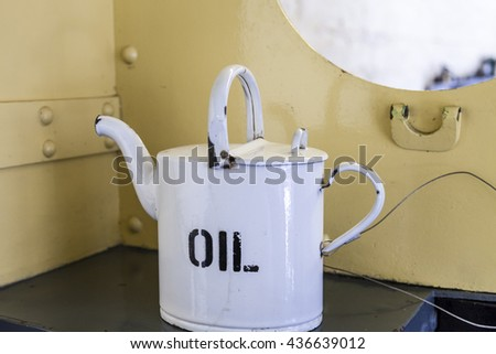 Oil can inside the cab of a  museum locomotive train - stock photo