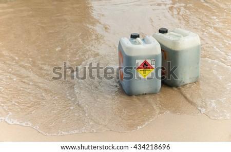 Oil Chemical gallon on the beach - stock photo