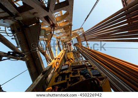 Oil derrick. View from the drilling floor. - stock photo