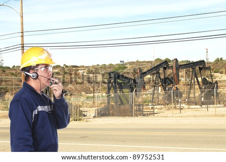 oil drill worker at oil field - stock photo