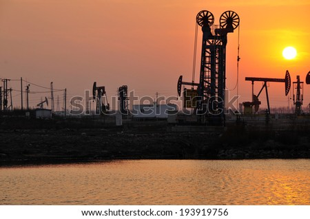 Oil drilling rig, tanghai county of hebei province oil fields in China   - stock photo