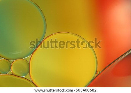 Oil drops on a water surface - abstract rainbow colored macro