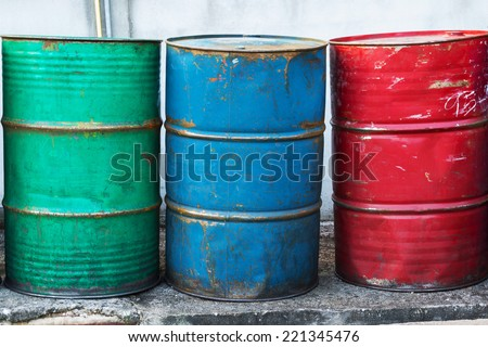 Oil Drums -- they are old and rusty and in various colors - stock photo