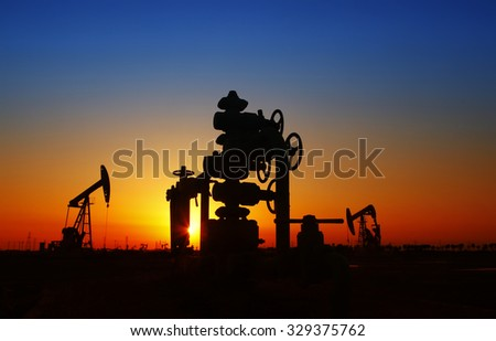 Oil field scene, Oil pipeline and pumping unit of the silhouette