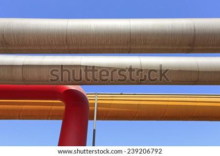 Oil field scene, oil pipelines and facilities - stock photo