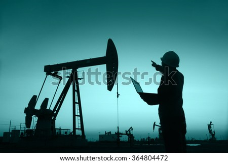 oil field, the oil workers are working - stock photo