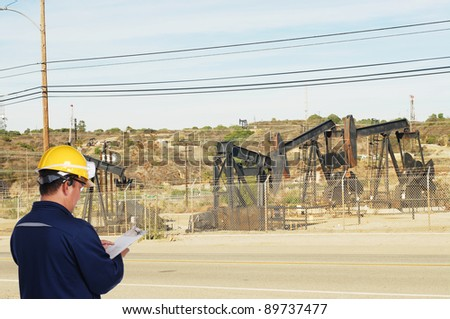 oil field worker on oil field - stock photo