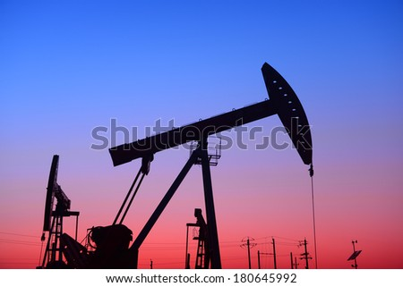 Oil fields in busy pumping unit  - stock photo