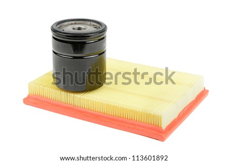 oil filter and air filter for a car isolated on white background - stock photo