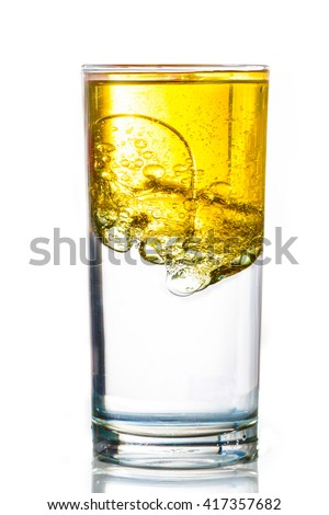 Oil flows in glass with water - stock photo