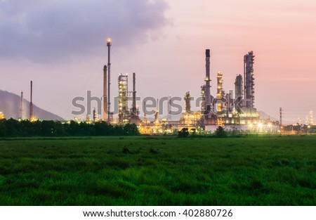 Oil, gas industry and refinery at sunrise with light orange sky from the right in the morning. - stock photo