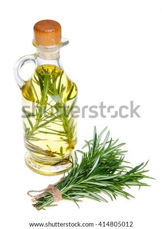 Oil in a bottle and fresh organic rosemary isolated on white, fresh organic herbs, healthy life, healthy food, nutrition - stock photo