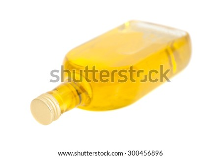 Oil In Glass Bottle On A White Background