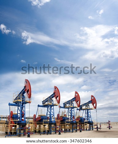 Oil industry and gas industry. Oil equipment. Blue sky and white clouds - stock photo