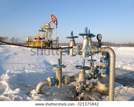 Oil industry. Construction and equipment in work. Oil pump and latch - stock photo