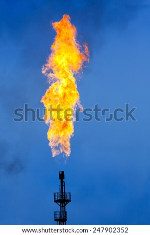 Oil Industry: Flare Stack - stock photo