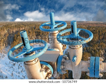 Oil industry in wild taiga. West Siberia. Aerial view. - stock photo