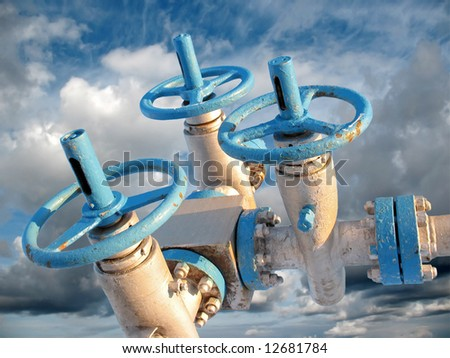Oil industry. Oil latch and grey clouds in the sky. - stock photo