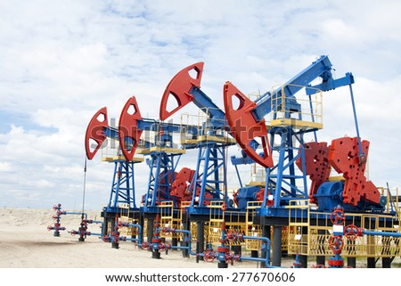 Oil industry. Oil pump on a oil field.