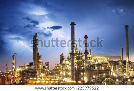 Oil indutry refinery - factory with lightning - stock photo