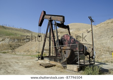 Oil is pumped on California lease using walking beam pumpjack