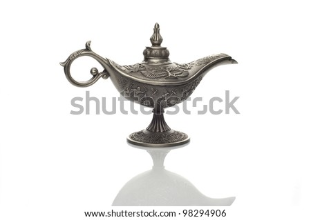 Oil lamp east design with egypt or arabic texture with reflection on white background - stock photo