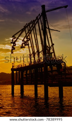 oil loading terminal in the evening - stock photo