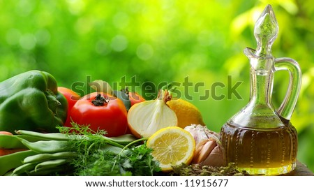 Oil Olive with vegetables and condiments.