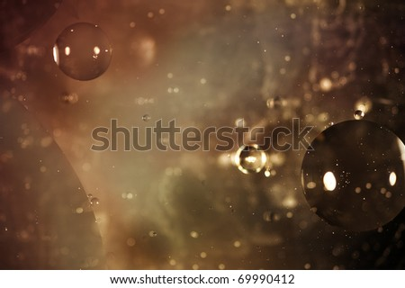 Oil on water photograph designed to appear like outer space background - stock photo