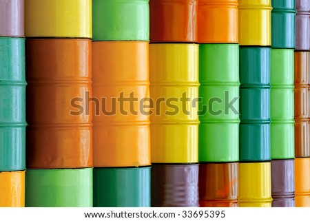 Oil or chemical drums stacked on top of each other. - stock photo