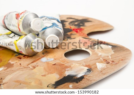 Oil paint on a palette - stock photo