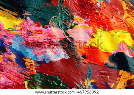 Oil paints multicolored closeup abstract background from above .